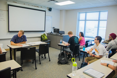 Professor Ethan Thompson jokes around with his Senior Media Studies class on the first day back.
