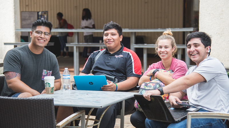Guillermo Maldonado (left) Mark Peralez, Jodry Linkins and Billy Guerra work on their laptops outside of the Starbucks Cafe.