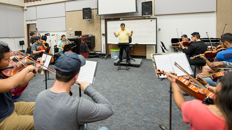 Dr Jose Flores leads the class during their concert orchestra practice.