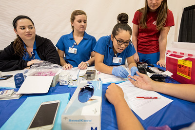 Danielle Pilsbury (left) Taylor Brown and Gabriela Zamudio during the HHM Fair in the Dugan.  View more photos:  https://islanduniversity.smugmug.com/Events/Events-By-Year/2016/092716-HHM-Health-Fair/