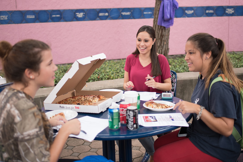 Students Melody Gartner (left), Susana Valdivia and Alyssa Olivares enjoy pizza as they fill out a survey during the Register to Vote event in the Hector P. Garcia Plaza.  View more photos: https://islanduniversity.smugmug.com/Events/Events-By-Year/2016/092716-All-In-Campus-Democracy/