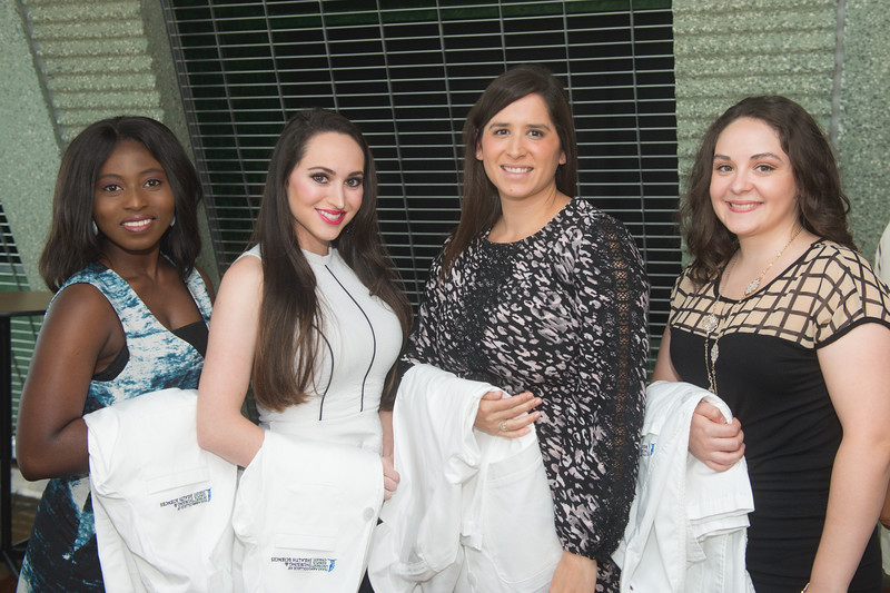 Maxyne Eshun (left), Victoria Duffy, Lindsey Cook and Araceli Colmenero gather for a photo prior to the white coat ceremony. 