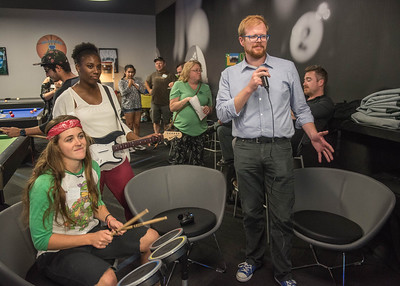 (Left to Right) Savannah Ryan, Kendra Johnson, and David Gurney playing Rock Band at the Comm Club Mixer.  More photos: https://islanduniversity.smugmug.com/Events/Events-By-Year/2016/092216-COMM-Club/i-dgMgsm6