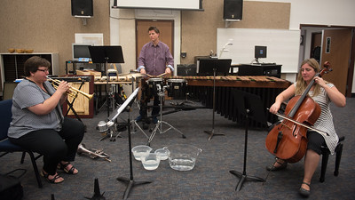 Mary Thorton (left) Matthew McClung and Carrie Pierce practice their Drumpetello perfomance for their future audio recording session.