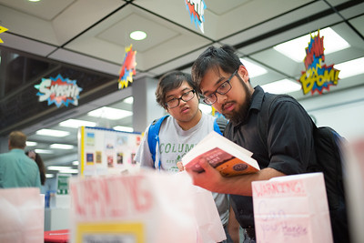 Jeremiah Banaag and Elijah Banaag look through the display of banned books during the Library's Banned Books Week event.