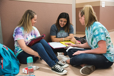 TAMUCC Students Baeleihj Kelly(left), Sabrina Castorena(middle) and Catherine Ringel(right) collectively study for a group project.