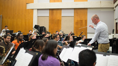 Dr. Brian Shelton directs the band during class in the Center for Arts.