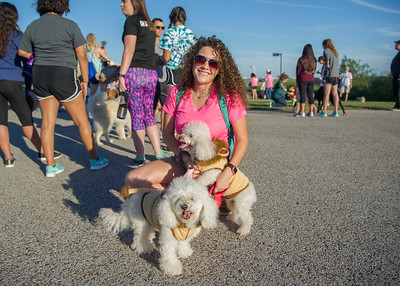 Andrea De Alba poses with her dogs Nala and Kiara during the 'Paws for a Cause' event held on the university's Hike and Bike Trail.