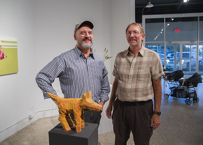 Jack Gron and Roger Steinberg pose for a photo during 'The Artist Is In The Building' event at the Islander Art Gallery.