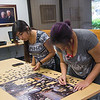 TAMU-CC Students Summer Cruz(left) and Kia Thomas(right) are close to finish with a puzzle in the Mary & Jeff Bell Library.