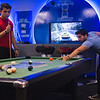 TAMUCC Students Johnthan Flores(left) and Pablo Alvarez(right) locked in an intense pool game in the Breakers Game Room.