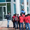 TAMU-CC Island ambassador Jesus Moncada conducts a campus tour to a group of students.