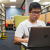 TAMUCC Student Tuan Bui quietly studies on the second floor of the Mary & Jeff Bell Library.