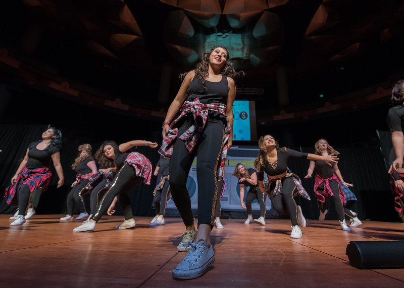 Students perform on stage during the annual Islander Revue in the Performing Arts Center.
