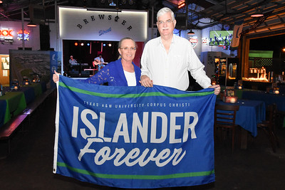 Dr. Flavius Killebrew (right) and his wife, Kathy, pose for a photo during the Islander Alumni Association's farewell party for the Killebrews.