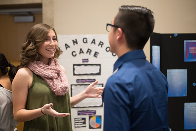 Hannah Lucero (left) speaks to Bryce Rogers about her presentation during the First-Year Symposium in the University Center.