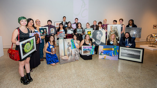 2016 Presidents Council Art Show participants pose for a group photo along with their art submissions.  View more photos: http://smu.gs/2g1GJxx