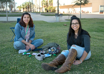 Students Aislinn Castillo and Julissa Ayala enjoy some time on the University Center East Lawn.