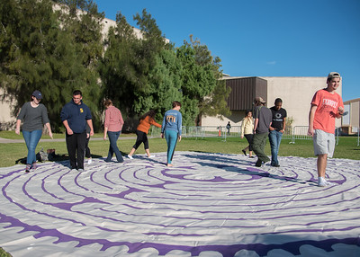 Students take a break from studying to partake in a labyrinth walk on the University Center East Lawn.