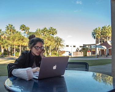 Student Selina Velasquez studies for her final exam in the Center for Instruction courtyard.