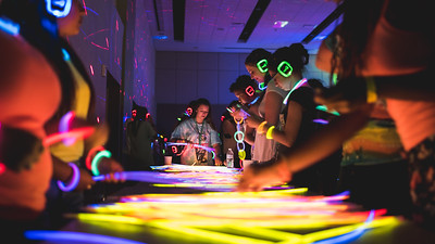 Students fashion themselves with glowsticks provided at the NSO Glow Party.