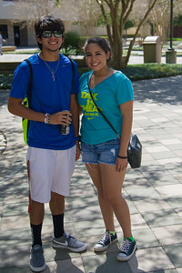 Freshman students Jaime U. and Abriana Ramirez fight the heat in exploration of their new campus.