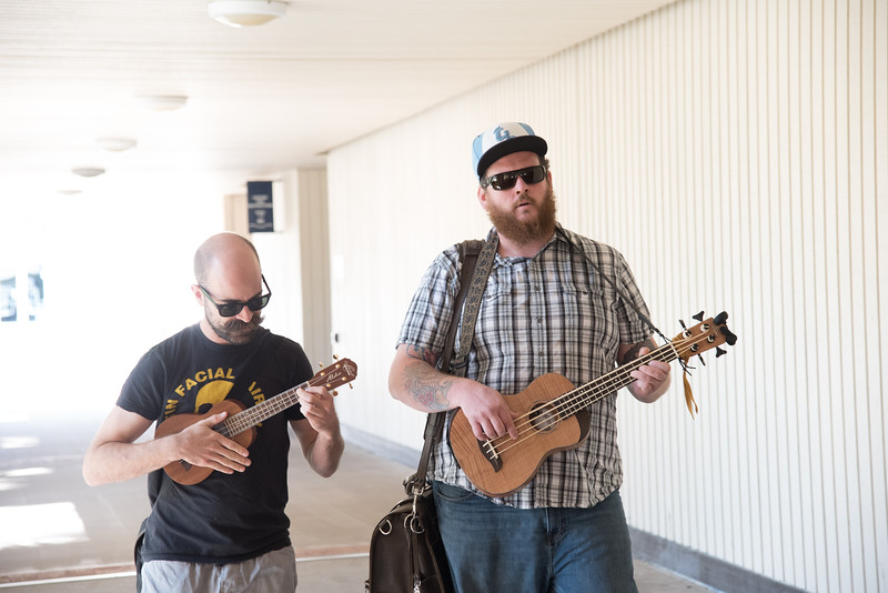Kyle bauer(left) and Paul Crothers parade through the breeze way uplifting spirits of Islanders during finals week.