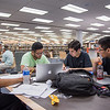 Students Oliver Belleza, Kyle Jacobs, Ellis Manoz, and Vincent Mai study collaboratively in the Mary and Jeff Bell Library for their calculus final.