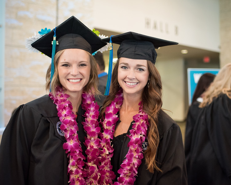 """Paige Runnels(left) and Taylor McKenna pose for a photo after recieving their Lei's for the Spring 2016 Commencement.<br /> <br /> More Photos: <a href=""""https://flic.kr/s/aHskwtWSi2"""">https://flic.kr/s/aHskwtWSi2</a>"""