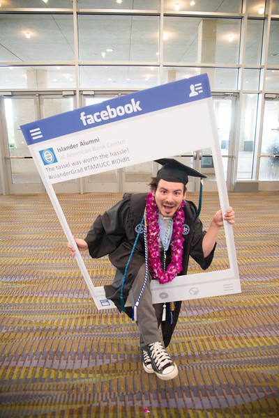Ishmael Lara poses for a photo during the 2016 Spring Commencement ceremony.