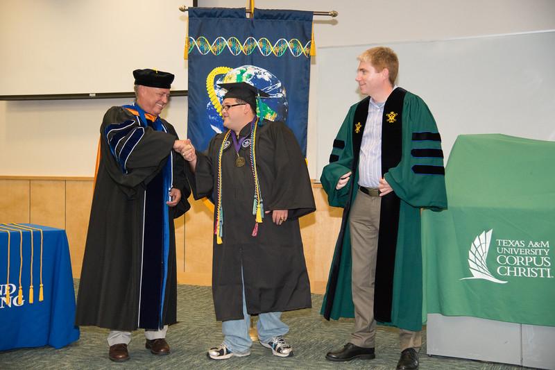 "Dean Frank Pezold(left) Matthew Cruz and Dr. Derek Hogan, during the 2016 College of Science and Engineering hooding recognition.<br /> <br /> More photos: <a href=""https://flic.kr/s/aHskzV279A"">https://flic.kr/s/aHskzV279A</a>"