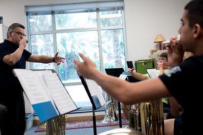 Dr. Dan T. Sipes goes over tuba techniques with students participating in band summer camps.