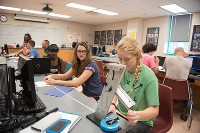 Ramatu Abdullah(far left) Rachael Crews and Madeleine wolters work together in their physics 1 lab.