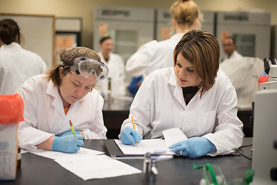 Amber Sullins(left) and Holly Brown work together in their gram-staining and acid-fast staining lab for micro biology.