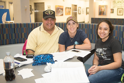 Raul Munoz(left) Amberly Pena and Jomira Ramos work together on their criminal justice studies in the Mary and Jeff Bell Library.