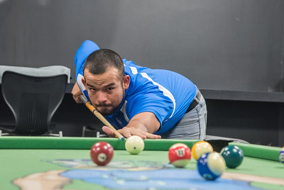 Student John Reed takes a break to play pool in the Breakers game room.