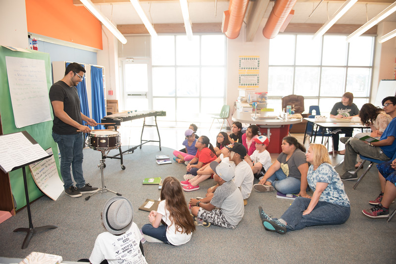 Emilio Monreal connects with students through his talent in music. During the TAMU-CC writing camp.