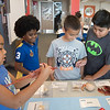 Bella Franklin (left) Noah Snyder, Jacob Segundo and Benjamin Herrera gather around the Texas State Aquarium's touch table. During the Young Writers Camp in the ECDC.