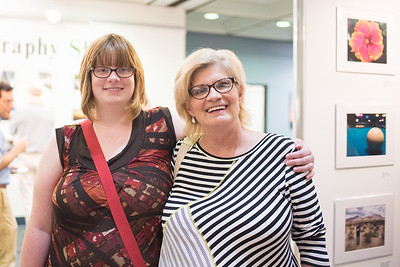 Elizabeth Mock (left) and Lisa Mock stop by the Islander Cell Phone Photography Show.