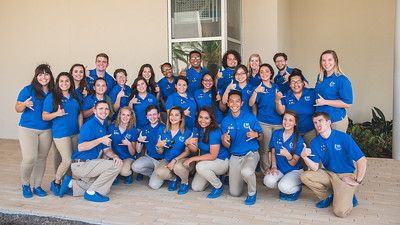 Orientation leaders gather for a group photo after a full day of assisting guests on the Island University.