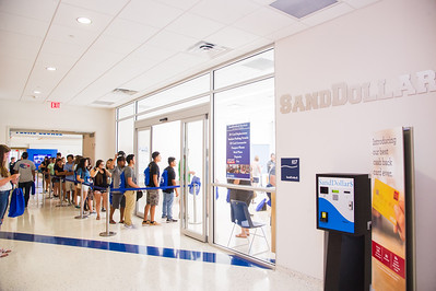 New students wait in line to recieve the sanddollar card during orientation.