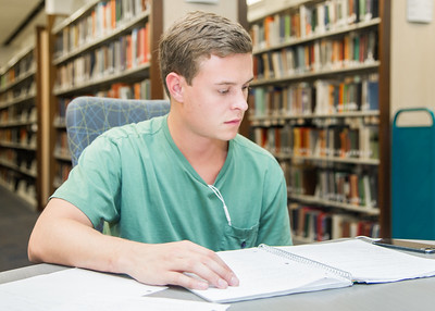 Evan Edwards studies for his intro. to chemistry course in the Mary and Jeff Bell Library