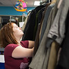 "Victoria Fanki works to organize costumes in the costume shop. ""I like working in the costume shop because the people are fun... and it's less dangerous then working n the scene shop."""