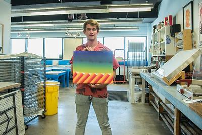Graduate student, Jack Wood working on his MFA Printmaking work.