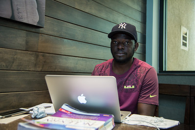 Student Rufael Vieyra works on assignments in the Starbucks Cafe.