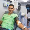 Sergio Dominguez donates blood on campus.