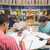 Joel Barrientos, Dakota Williams and Austen Villanueva study in the UC.
