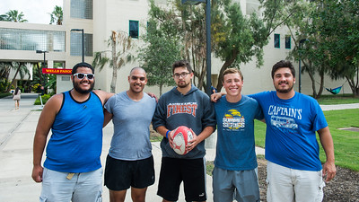 Members of the Rugby Club, Christian Rosado (left), Mohamed Elleithy, Jordan Scott, Tommy Batterson, and Ben Rentfrow, pose for a group picture.
