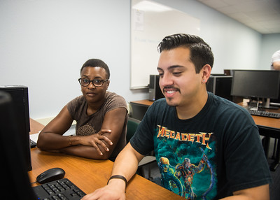 Tutor Lisamarie Gunter (left) helps student Alec Flores on his assignment for class in the Texas A&M University Corpus Christi - CASA.  Click on the link for more information on CASA's services: http://casa.tamucc.edu/