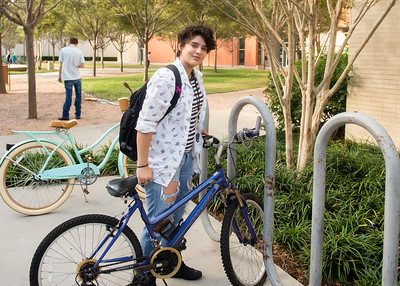 Islander student Joyce Villegas locks her bike in one of our many racks on the Island University.